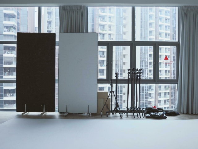 photography equipment in a room with city view