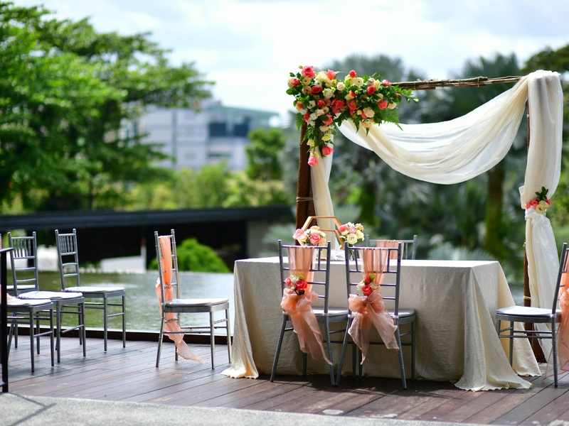 outdoor wedding rom setup with garden and lake's view