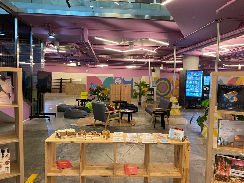 coworking space and living room area with a lot of amenities