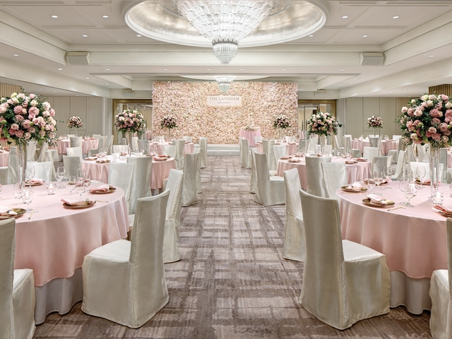 wedding venue with white and soft pink decorations