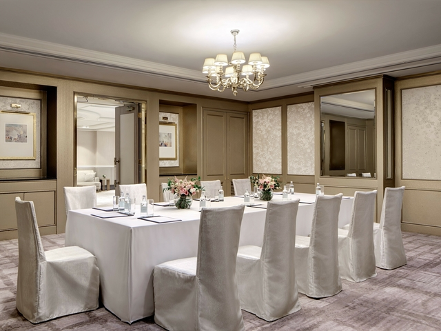 white tables and chairs in a luxurious private room