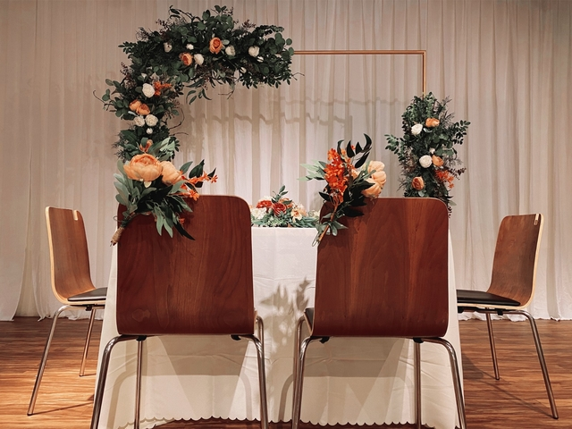 white dining table and brown chair with floral decorations