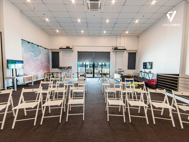 white chairs in a white room with high ceiling