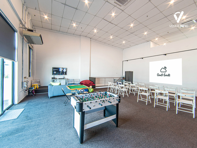 foosball table in a room with white chairs
