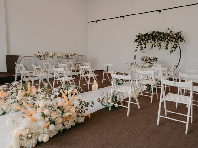 white chairs in a room with floral decoration