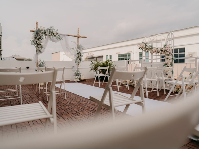 white chairs on an outdoor space with white flower decoration