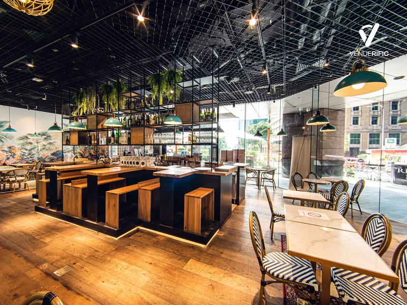 a modern designed restaurant with hanging lights