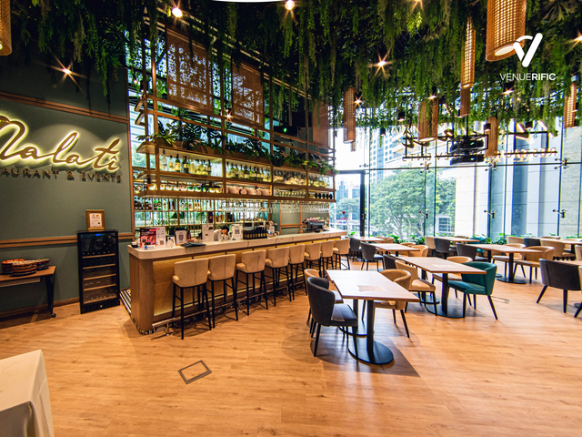 restaurant with a bar and hanging plants decoration