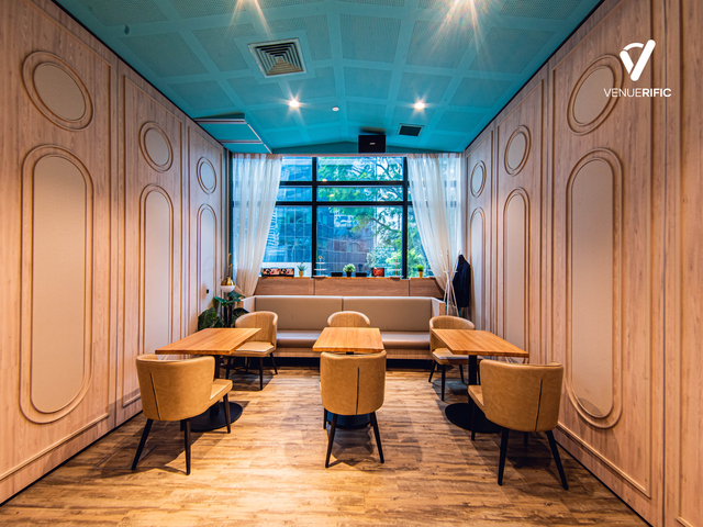 a comfortable meeting room with dining table and sofa