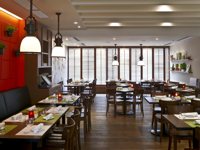 restaurant with wooden floor and hanging lights