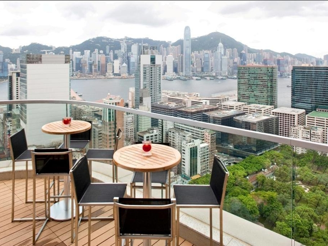rooftop seating area with panoramic view of hong kong skyline