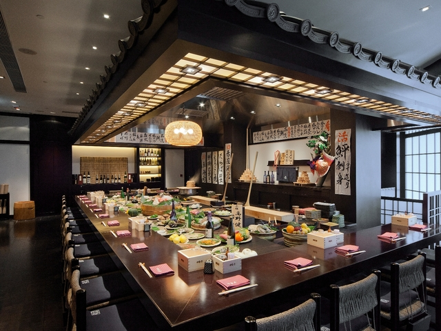 sushi bar area with an open kitchen concept