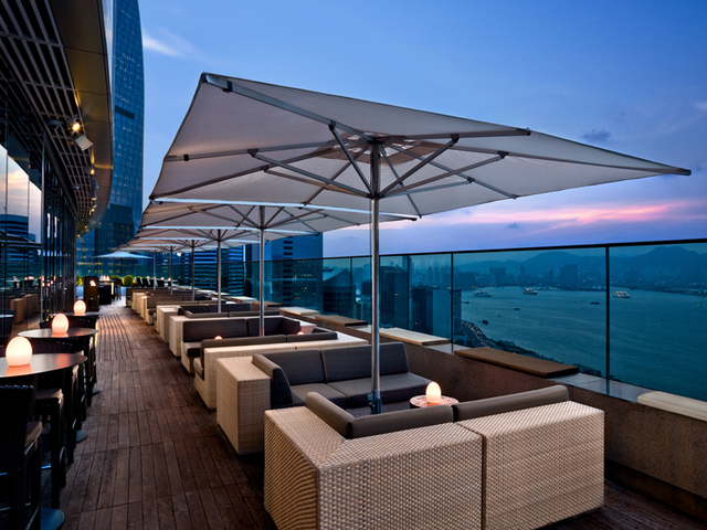 outdoor dining area overlooking  evening sea view