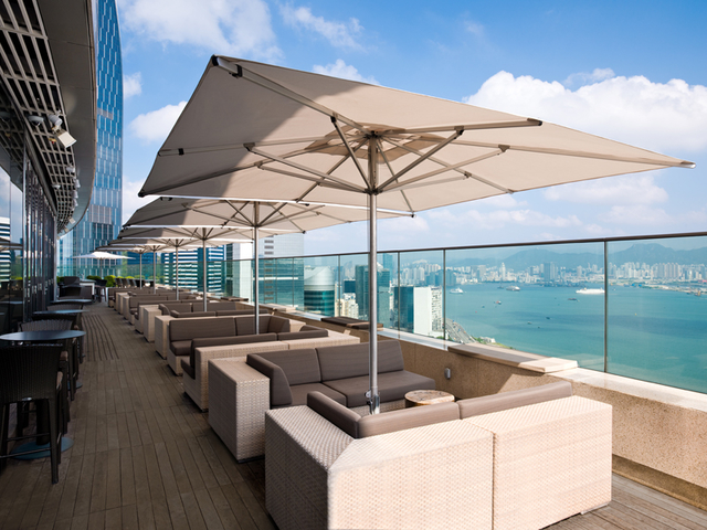 outdoor dining area overlooking day sea view