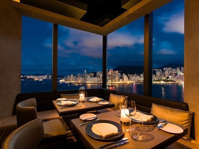 dining space of ava restaurant and slash bar with the panoramic view of hong kong