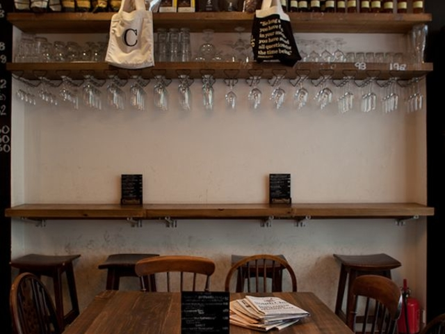 indoor restaurant with hanging glasses on the shelf