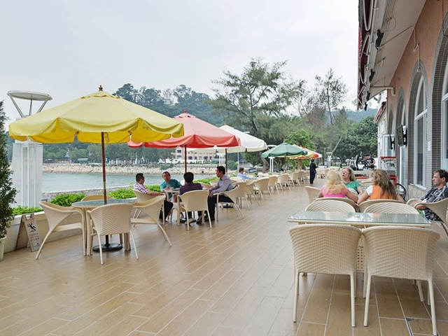 casual outdoor dining establishment accompanied with the sea view and the warmth of the sun