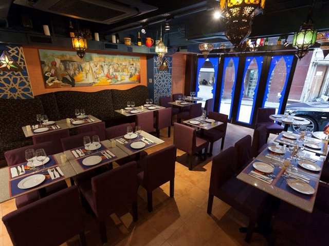 indoor restaurant with tasteful pattern fabrics and moroccan lanterns and pottery