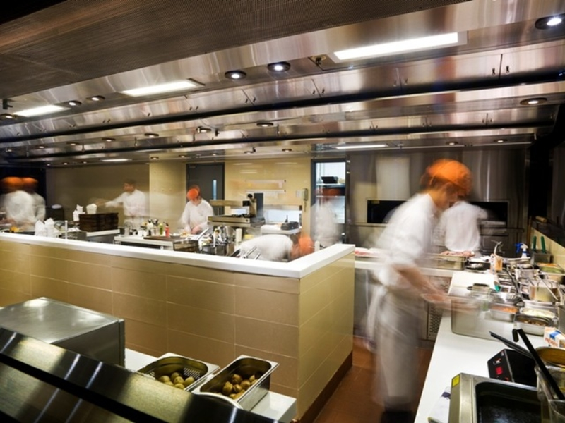 chefs are preparing the food in the kitchen area