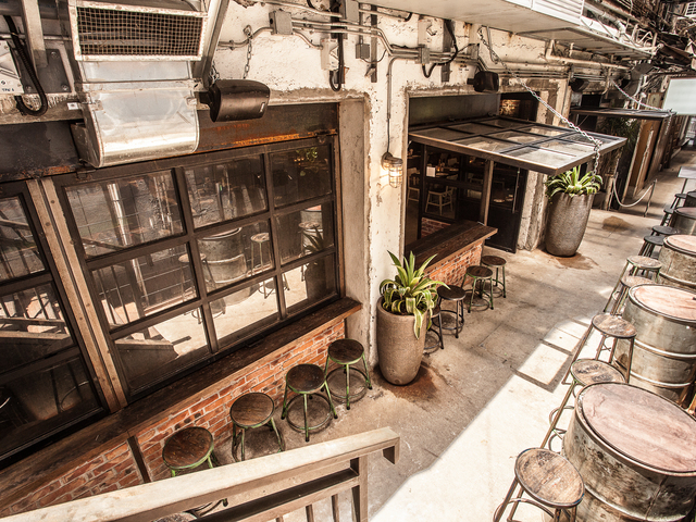 the outdoor seating area of brickhouse hong kong