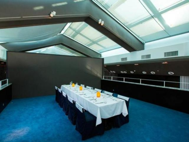 private dining room with buffet lines and blue carpets