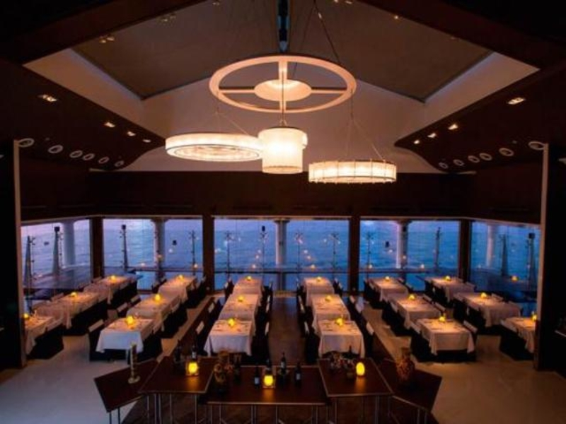 fine dining restaurant with floor to ceiling window featuring sea view of hong kong