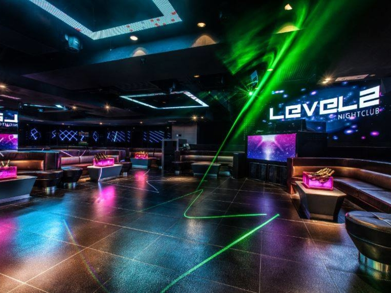 dance floor of level 2 nightclub surrounded with sofa tables