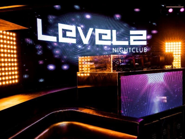 dj table area with level 2 nightclub of logo at the giant tv screen
