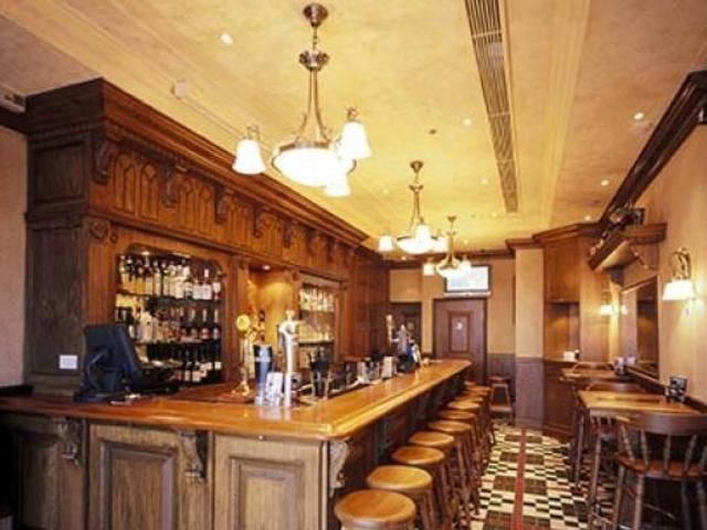 vintage bar setting with chandelier and wooden furniture