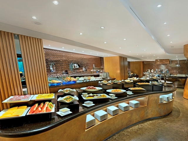 buffet food line with a lot of food selection
