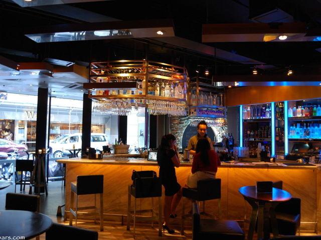 bar seating area where girls are enjoying their conversation