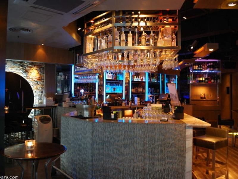 bar area with various selection of alcohol drinks on the rack
