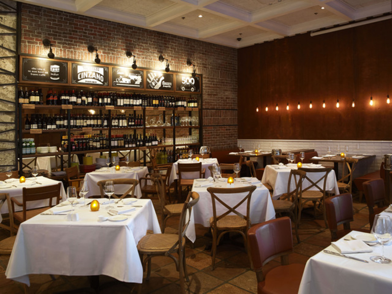 red brick walls, vintage blackboards with rustic shades at the main dining area