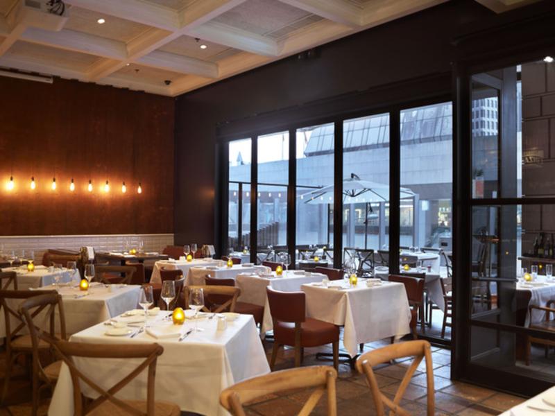 indoor italian restaurant with floor to ceiling window
