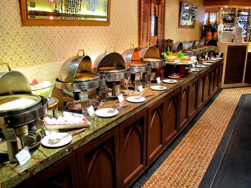 buffet line across the restaurant and near the wine shelves