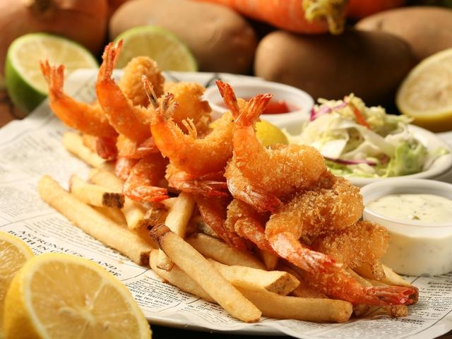 fried prawn served with frenh fries and salad