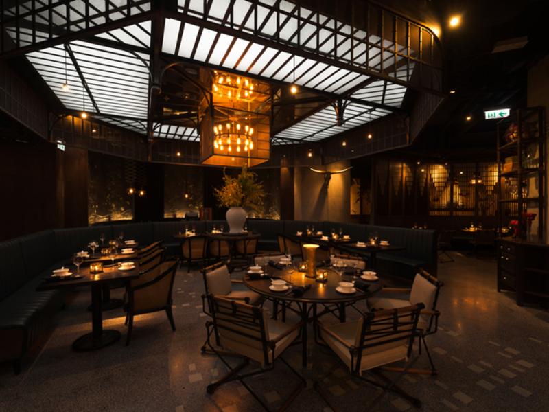 restaurant dining setting with natural lighting from ceiling