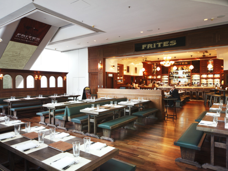 spacious main dining space with lot of tables and overlooked the bar area