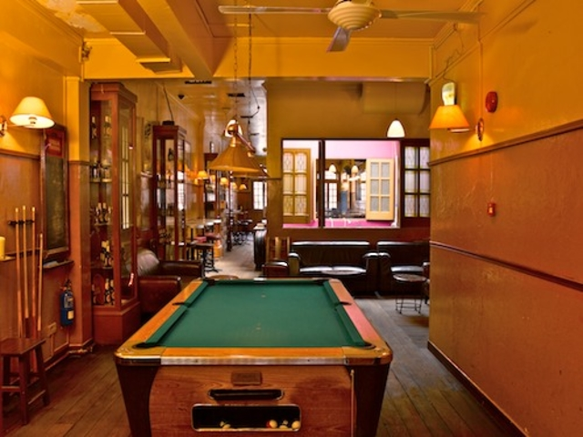 bar with billiard table and natural light