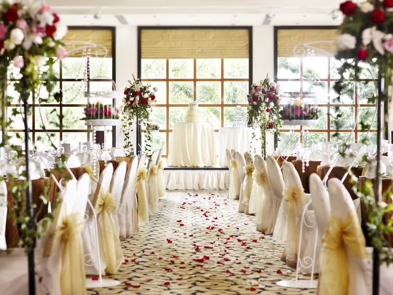 singapore wedding venue with large windows and white themed decorations