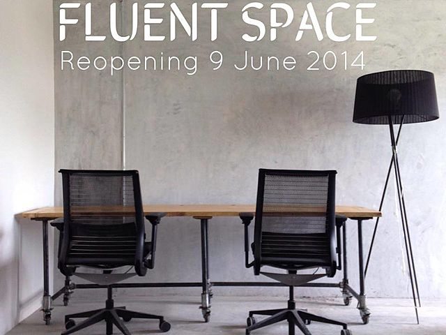 coworking space chairs and table for two people