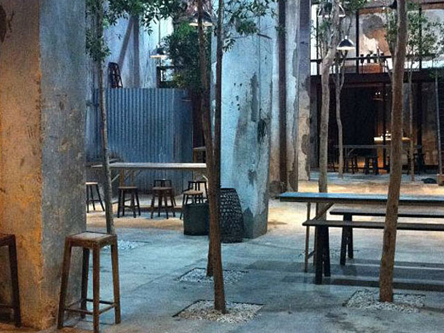 casual meeting space in penang with outdoor area and trees