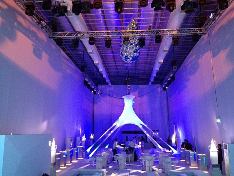 white-themed event ballroom with stage lightings