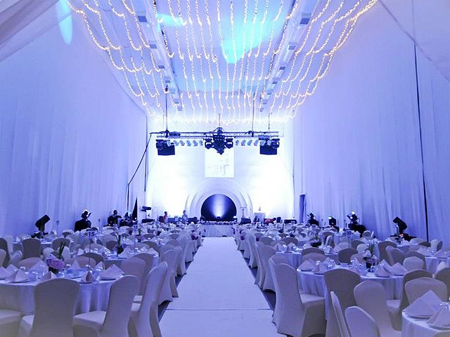 gala dinner event space equipped with white drapes and stage