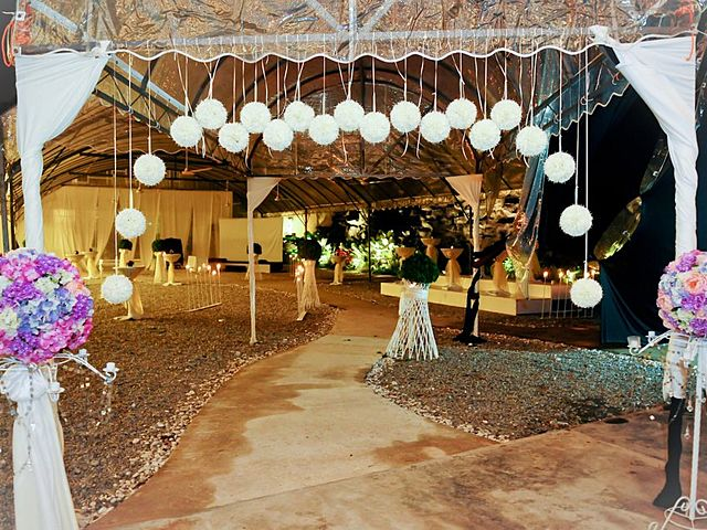 semi-outdoor wedding entrance decorated with white hanging balls