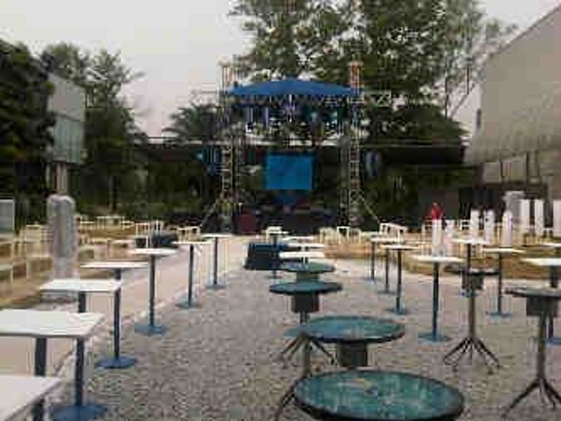 outdoor space in kuala lumpur equipped with stages and many cocktail tables