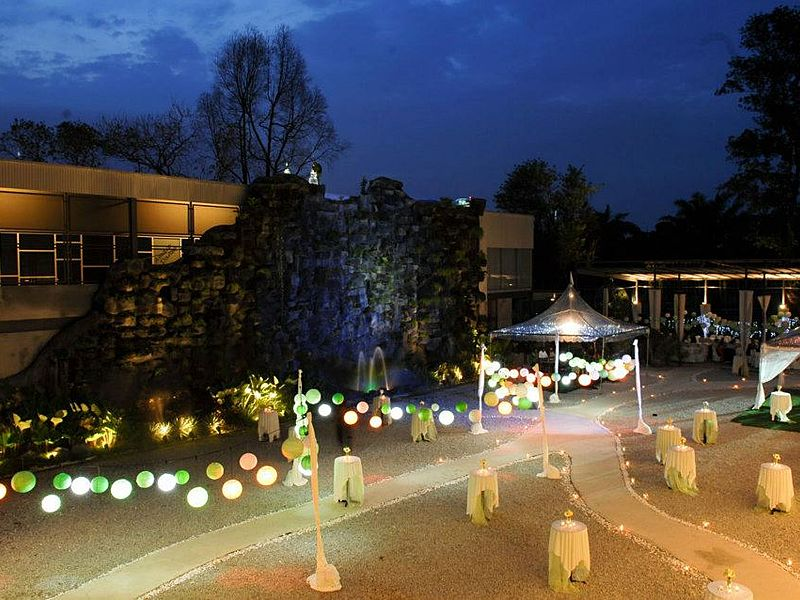 garden event space with colourful lantern lamp and pathway