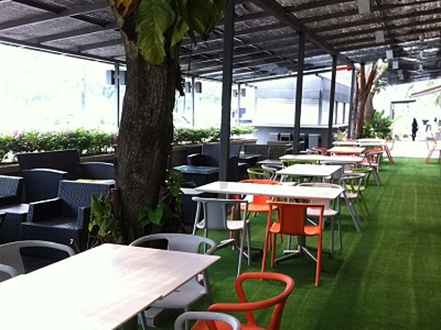 semi-outdoor dining area with a grass floor