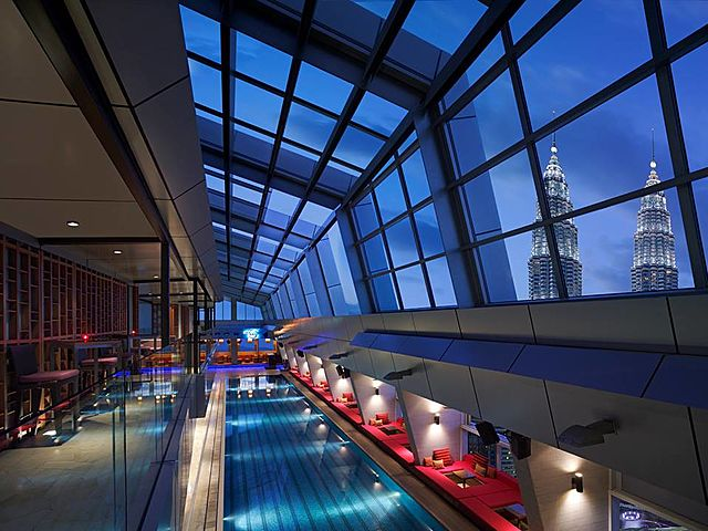 kuala lumpur bar with indoor sky pool and large glass roof