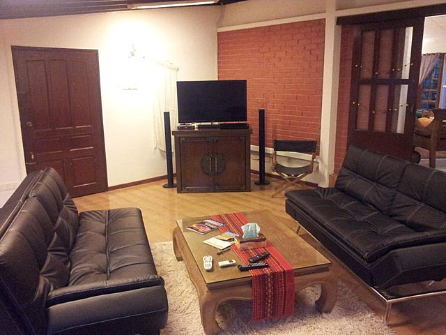 small living room villa with television and black couches
